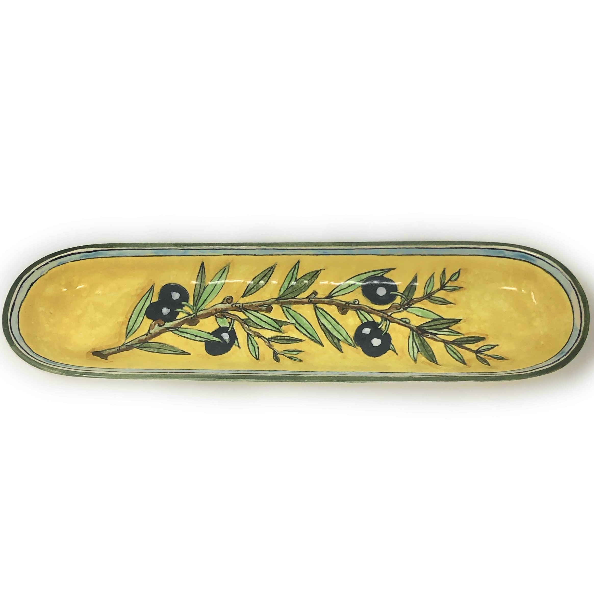 Tray olives yellow background